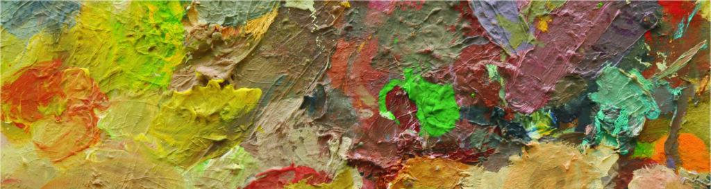 Fragment papieru pomalowany różnokolorowymi farbami